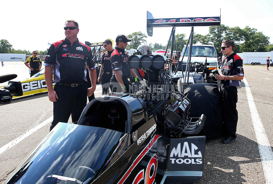 Aug. 16, 2013; Brainerd, MN, USA: Crew members for NHRA top fuel dragster driver Steve Torrence during qualifying for the Lucas Oil Nationals at Brainerd International Raceway. Mandatory Credit: Mark J. Rebilas-