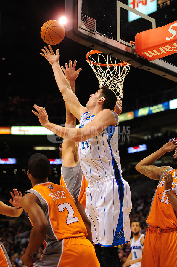 Dec. 26, 2011; Phoenix, AZ, USA; New Orleans Hornets forward/center Jason Smith attempts a rebound during the game against the Phoenix Suns at the US Airways Center. The Hornets defeated the Suns 85-84. Mandatory Credit: Mark J. Rebilas-USA TODAY Sports