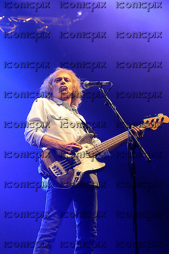 STATUS QUO - bassist Alan Lancaster - performing live on the final date of the Frantic Four Reunion Tour at Wembley Arena in London UK - 17 Mar 2013.  Photo credit George Chin/IconicPix