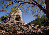 A tree frames a view of the historic stone ruins of a windmill at the Annaberg Plantation in St. John, US Virgin Islands