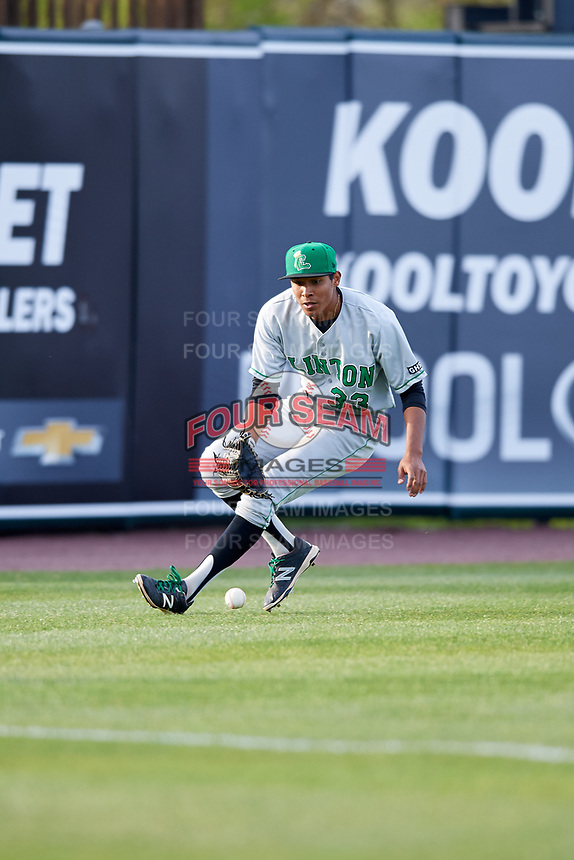 Clinton LumberKings left fielder Dimas Ojeda (33) fields a ball during a game against the West Michigan Whitecaps on May 3, 2017 at Fifth Third Ballpark in Comstock Park, Michigan.  West Michigan defeated Clinton 3-2.  (Mike Janes/Four Seam Images)