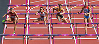 03 AUG 2012 - LONDON, GBR - Jessica Ennis (GBR) (second from left) of Great Britain clears a hurdle during her heat in the women's heptathlon at the London 2012 Olympic Games athletics in the Olympic Stadium in the Olympic Park in Stratford, London, Great Britain (PHOTO (C) 2012 NIGEL FARROW)