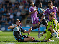 Luke O'Nien of Wycombe Wanderers goes goes to beating Goalkeeper Luke McCormick of Plymouth Argyle during the Sky Bet League 2 match between Wycombe Wanderers and Plymouth Argyle at Adams Park, High Wycombe, England on 12 September 2015. Photo by Andy Rowland.