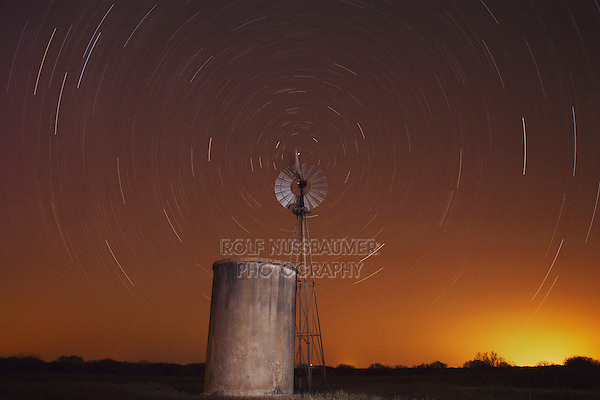 Wind mill at night with star trails, Sinton, Corpus Christi, Coastal Bend, Texas, USA