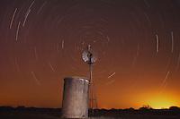 Wind mill at night with star trails, Sinton, Corpus Christi, Coastal Bend, Texas, USA