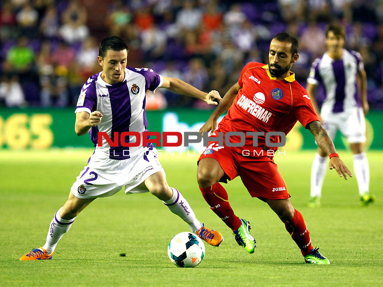 Real Valladolid¬¥s Rukavina (l) and Getafe's  Diego Castro during La Liga match.August 31,2013. Foto © nph / Victor Blanco)