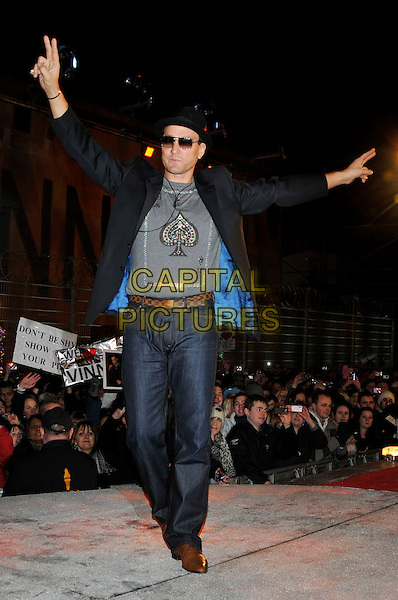 VINNIE JONES.Leaving The Big Brother House, Celebrity Big Brother Final 2010, Borehamwood, Hertfordshire, UK.29th January 2010.final BB CBB full length black hat hands v sign peace arms raised up gesture grey gray jacket blazer pinstripe jeans t-shirt sunglasses brown shoes belt .CAP/PL.©Phil Loftus/Capital Pictures.