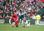 Steve Chattel of Nottingham Forest tussles with Stan Collymore of Liverpool - Premier League - Nottingham Forest v Liverpool - City Ground - Nottingham - England - 23rd March 1996 - Picture Simon Bellis/Sportimage