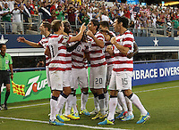 Clarence Goodson #21 of the USMNT, Michael Parkhurst #15,DaMarcus Beasley #7, Stuart Holden #11, Jose Torreso #16 and Chris Wondolowski #19 joins Eddie Johnson #26 congratulating Landon Donovan #10 for scoring a goal from an assist by Alejandro Bedoya #20 against Honduras on July 24, 2013 at Dallas Cowboys Stadium in Arlington, TX. USMNT won 3-1.