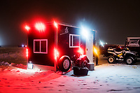 The night party scene during the 39th Annual International Eelpout Festival, at Leech Lake in Walker, Minnesota from February 22-25, 2018. Crowds that are more than 10 times the population of tiny Walker, Minn. (pop. 1,069) gather on Minnesota&rsquo;s third largest lake (112,000-acres), Leech Lake, for a festival named for one of the ugliest bottom-dwelling fish, the eelpout.<br /> <br /> Photo by Matt Nager