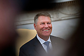 """Klaus Iohannis, Romania's president, smiles during a meeting with United States President Donald J. Trump, not pictured, in the Oval Office of the White House in Washington, D.C., U.S., on Tuesday, Aug. 20, 2019. Trump said today he's """"not ready to make a deal with China,"""" but adds Beijing wants an agreement and something could happen soon. <br /> Credit: Andrew Harrer / Pool via CNP"""