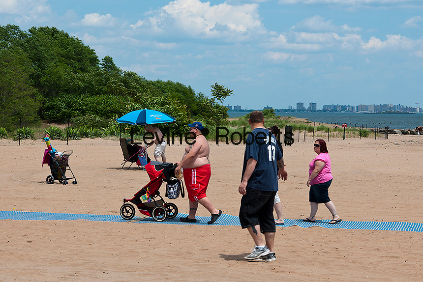 Cedar Grove Beach in Staten Island in New York is seen on Sunday, June 3, 2012. Formerly a private summer vacation community the city condemned them via eminent domain int he 1960's for a proposed Robert Moses parkway. The parkway was never built and the owners were allowed to lease them from the city up until 2010 when the plans to make the beach public came to fruition. The bungalows, in various states of disrepair, will be torn down with a few renovated and repurposed for park use. (© Richard B. Levine)