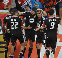 D.C. United defender Dejan Jakovic (8) celebrates with teammates his score in the 45th minute of the game.  D.C. United defeated The New England Revolution 3-2 at RFK Stadium, Saturday May 26, 2012.