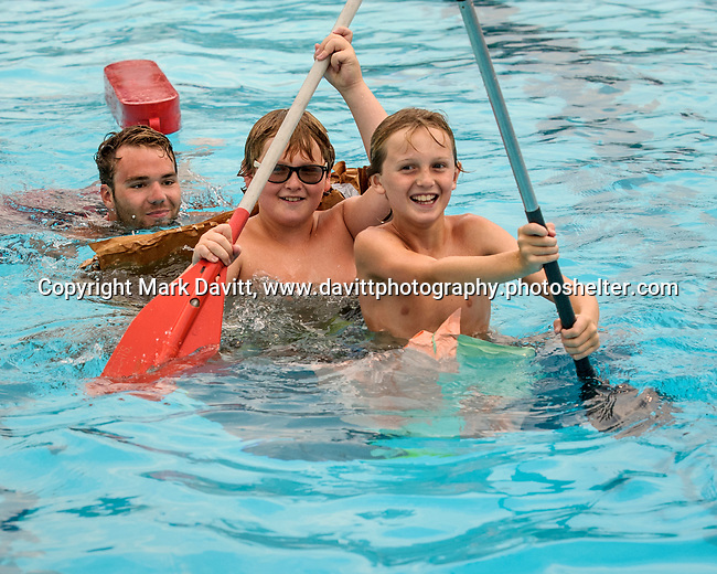 Indianola Park and Recreations hosted cardboard boat races at the Veteran's Memorial Aquatic Center July 22.<br /> <br /> Sinking <br /> Leo Fox and Vinny Fox<br /> SS Screwup<br /> <br /> Joe Sams<br /> Life guard