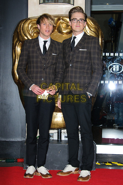 Dougie Poynter & Tom Fletcher of McFly.Arrivals at the British Academy Children's Awards at The Hilton, Park Lane, London, England..November 25th, 2012.BAFTA full length black trousers brown check suit jacket matching glasses hand in pocket.CAP/CJ.©Chris Joseph/Capital Pictures.