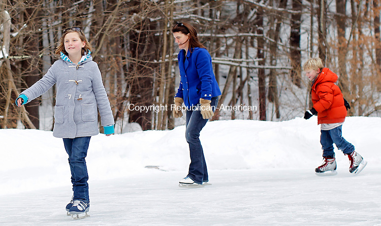 Barkhamsted, CT- 30, January 2010-013011CM05  Jessica Longmoor, 11, of Barkhamsted (left) enjoys an afternoon of skating with her family, including, mother Kristen and younger brother, Aaron, during the annual ice skating party at Squires Tavern in Barkhamsted Sunday afternoon.  The event was put on by the Barkhamsted Historical Society and featured a bonfire, hot echolocate and tours of the historic tavern.  Christopher Massa Republican-American