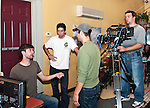 A discussion inside The Cascades. Shown (L to R) are director Brian McAllister, director of photography Dennis Donovan, producer Bob Cammisa and assistant camera/key grip Phil Toran.