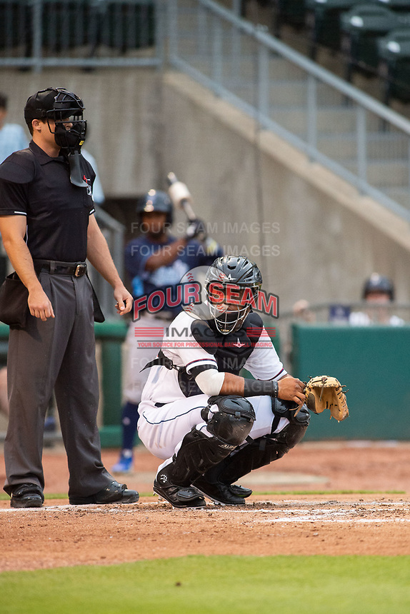 Northwest Arkansas Naturals catcher Meibrys Viloria (22) looks back to the dugout Wednesday, May 1, 2019, at Arvest Ballpark in Springdale, Arkansas. (Jason Ivester/Four Seam Images)