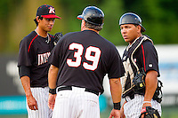 Kannapolis Intimidators manager Tommy Thompson #39 has a chat with Terance Marin #1 and Miguel Gonzalez #32 during the South Atlantic League game against the Greensboro Grasshoppers at Fieldcrest Cannon Stadium on June 19, 2011 in Kannapolis, North Carolina.  The Intimidators defeated the Grasshoppers 9-7.   (Brian Westerholt / Four Seam Images)