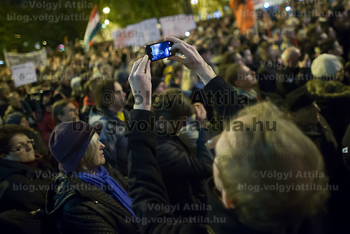 Participant takes a photo during a protest against the planned Internet tax in Budapest, Hungary on October 28, 2014. ATTILA VOLGYI
