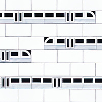 Subway!, a waterjet jewel glass mosaic, shown in Absolute White, Obsidian, and Alabaster, is part of the Kiddo collection by Cean Irminger for New Ravenna.