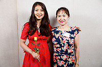 Contestant Nicolette Chin of Singapore and host family member Carol Tai pose at a photo booth during the opening reception and dinner of the 11th USA International Harp Competition at Indiana University in Bloomington, Indiana on Wednesday, July 3, 2019. (Photo by James Brosher)