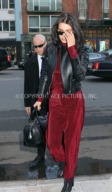 www.acepixs.com<br /> <br /> March 21 2017, New York City<br /> <br /> Model Bella Hadid wears a biker jacket and red jumpsuit as she arrives at her East Village apartment on March 21 2017 in New York City<br /> <br /> By Line: Philip Vaughan/ACE Pictures<br /> <br /> <br /> ACE Pictures Inc<br /> Tel: 6467670430<br /> Email: info@acepixs.com<br /> www.acepixs.com