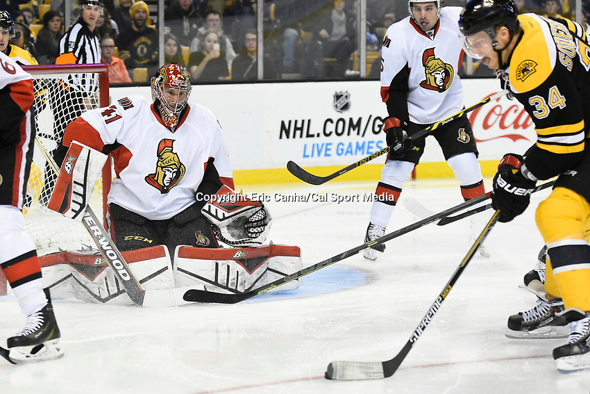January 3, 2015 - Boston, Massachusetts, U.S. - Ottawa Senators goalie Craig Anderson (41) keeps his eyes on the puck controlled by Boston Bruins center Carl Soderberg (34)  during the NHL game between the Ottawa Senators and the Boston Bruins held at TD Garden in Boston Massachusetts. Eric Canha/CSM