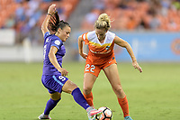 Houston, TX - Saturday June 17, 2017: Camila Martins Pereira attempts to steal the ball from Camille Levin  during a regular season National Women's Soccer League (NWSL) match between the Houston Dash and the Orlando Pride at BBVA Compass Stadium.