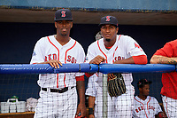 Salem Red Sox pitcher Joan Martinez (20) and pitcher Algenis Martinez (45) in the dugout before the first game of a doubleheader against the Potomac Nationals on June 11, 2018 at Haley Toyota Field in Salem, Virginia.  Potomac defeated Salem 9-4.  (Mike Janes/Four Seam Images)
