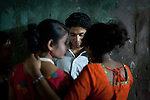 "Faridpur Brothel is the second to largest brothel in Bangladesh. (17 registered brothels in the country) 600+ girls live in a hidden neighboorhood accesible through one of the six alleyways, covered with small ragged curtains mimicking doors. Many girls are under aged - the ""legal"" age being 18. The chhukris flirt with clients trying to ma. March 16, 2011. Gabriela Barnuevo"