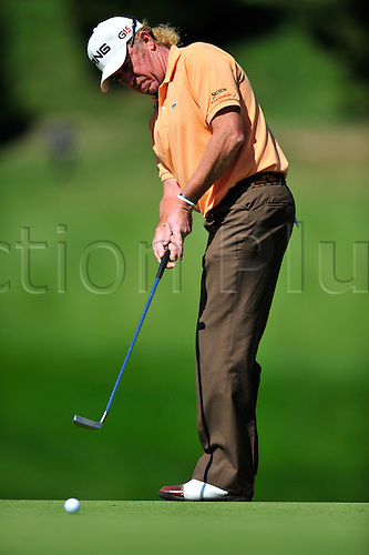 6th September 2009 - Miguel Angel Jimenez (ESP) putts on the 7th green during final round play at the Omega European Masters in Crans Montana, Switzerland. Photo: John Middlebrook/Actionplus. UK Licenses Only.