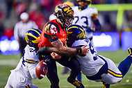 College Park, MD - NOV 11, 2017: Maryland Terrapins quarterback Ryan Brand (16) is hit by Michigan Wolverines  defensive back Lavert Hill (24) and defensive lineman Bryan Mone (90) during game between Maryland and Michigan at Capital One Field at Maryland Stadium in College Park, MD. (Photo by Phil Peters/Media Images International)