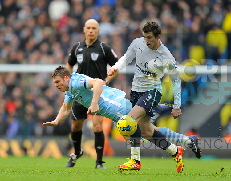 Gareth Bale  of Tottenham gets past James Milner of Manchester City.Barclays Premier League.Manchester City v Tottenham at the Eithad Stadium, Manchester 22nd January, 2012..Sportimage +44 7980659747.picturedesk@sportimage.co.uk.http://www.sportimage.co.uk/.Editorial use only. Maximum 45 images during a match. No video emulation or promotion as 'live'. No use in games, competitions, merchandise, betting or single club/player services. No use with unofficial audio, video, data, fixtures or club/league logos.