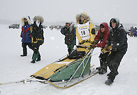 Saturday February 25, 2006 Willow, Alaska.   Ellen King is escorted to the start line at the start day of the Junior Iditarod sled dog race.  Willow Lake.