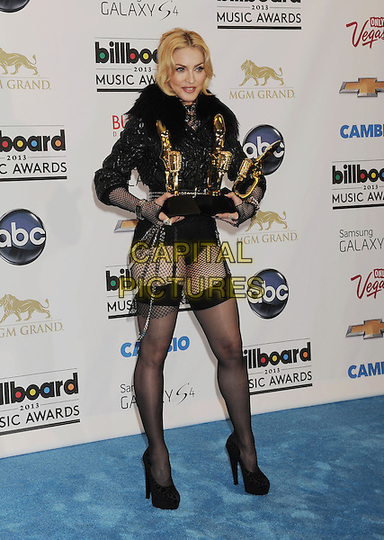 Madonna.at the 2013 Billboard Music Awards at the MGM Grand Garden Arena in Las Vegas, Nevada, USA, May 19th 2013..inside awards press room full length black fishnet tights stockings suspenders shoes jacket pants knickers fur collar awards winner trophies fingerless gloves .CAP/ROT/TM.©Tony Michaels/Roth Stock/Capital Pictures