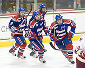 Chris Ickert (Lowell - 2), Matt Ferreira (Lowell - 17), Chad Ruhwedel (Lowell - 3) and Shayne Thompson (Lowell - 23) celebrate Thompson's goal. - The Boston College Eagles defeated the visiting University of Massachusetts-Lowell River Hawks 5-3 (EN) on Saturday, January 22, 2011, at Conte Forum in Chestnut Hill, Massachusetts.