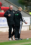 St Johnstone v Inverness Caley Thistle....07.04.12   SPL.Terry Butcher has a laugh with 4th official Mat Northcroft after Kenny Gillet tripped and fell.Picture by Graeme Hart..Copyright Perthshire Picture Agency.Tel: 01738 623350  Mobile: 07990 594431