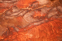 Within the cave tombs of Petra, complex patterns and color occur within the sandstone walls and ceilings.