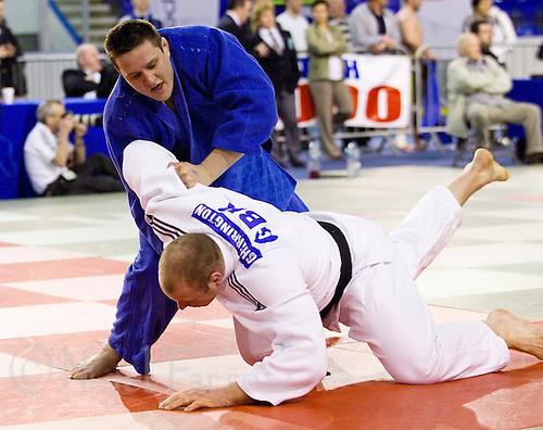 27 MAR 2011 - SHEFFIELD, GBR - Christopher Sherrington (white) v Matthew Clempner (blue) - men's over 100kg category - English Senior Open Judo Championships (PHOTO (C) NIGEL FARROW)