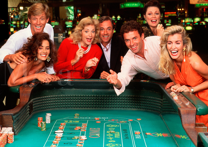 Couples enjoying themselves in casino