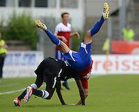 3. Fussball Bundesliga:  2. Spieltag    Saison   2012/2013   SpVgg Unterhaching  - FC Hansa Rostock   28.07.2012 Alexandre Noel Mendy (li, FC Hansa Rostock) gegen Marcel Kappelmeier (Unterhaching)