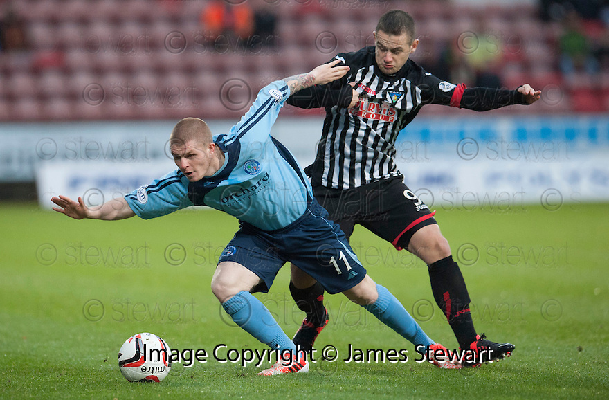 Forfar's Craig Storie holds off Pars' Ryan Wallace.