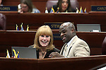 Guest Lynne Hansen talks with Assemblyman Kelvin Atkinson, D-North Las Vegas, on the Assembly floor Friday morning, May 6, 2011, at the Legislature in Carson City, Nev..Photo by Cathleen Allison