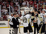 12 June 2009: Pittsburgh Penguins captain Sidney Crosby (87) kisses the Stanley Cup Trophy after receiving it at the end of game seven of the NHL Stanley Cup Finals between the Pittsburgh Penguins and Detroit Red Wings, at Joe Louis Arena, in Detroit, Michigan. Pittsburgh won 2-1 to clinch the title. Crosby became the youngest ever NHL captain to win the Stanley Cup...***** Editorial Use Only *****