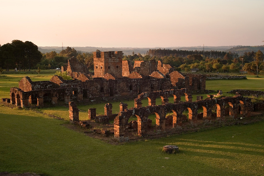 Evening light sweeps over the ruins of the Jesuit mission church at Trinidad de Paraná (Parana with acute accent on final a), Paraguay, where the bell tower of the site's first of two churches stands. Scores of Jesuit missions in the area where Paraguay, Argentina and Brazil meet were built in the 17th century and abandoned when the Jesuits were expelled in the 18th century. Ruins of some of these missions still haunt hilltops in the region. (Kevin Moloney for the New York Times)