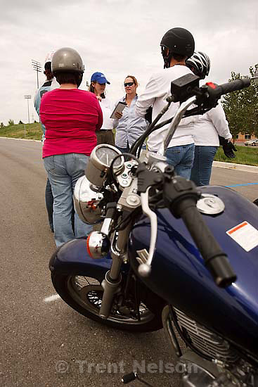 West Jordan - Laura Barnard (in blue baseball cap) teaching a motorcycle basic rider course put on by Motorcycle Rider Training at Salt Lake Community College's Jordan campus Saturday, August 29 2009.