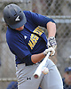Luke O'Mahony #19, Massapequa first baseman, drives in a run with single in the top of the first inning of a Nassau County varsity baseball game against host Oceanside High School on Monday, April 24, 2017. Oceanside won by a score of 9-7.