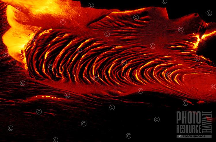 Hot pahoehoe lava flow at Kilauea volcano, Hawaii volcanos national park, Big Island, Hawaii