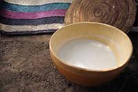 Akadaney, Central Niger, West Africa.  Fulani Nomads.  Calabash of Camel's Milk.